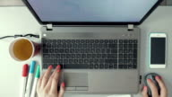 Female hands working on laptop on graphic design video
