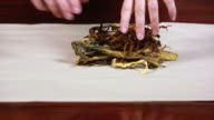 HD Female hands wraping dehydrated herbs video