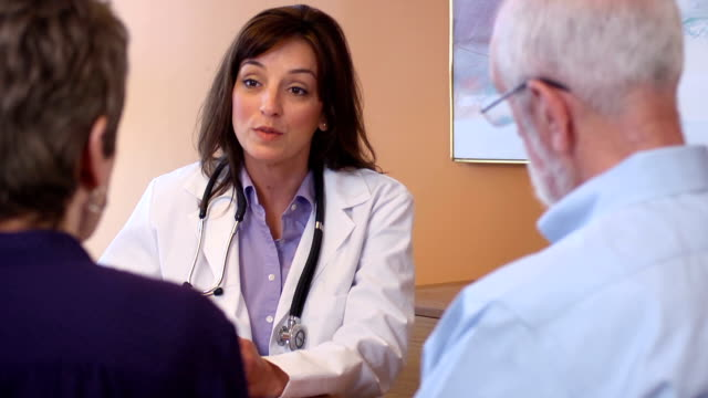 Female Healthcare Professional Talks with Senior Couple video
