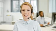 LD Female helpline operator on a video call with customer video