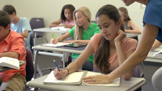 Female High School Teacher Taking Class video