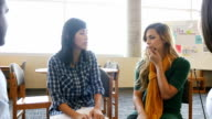 A female Hispanic STEM high school student is emotional in a study or support group video