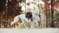 SLO MO LD Female horse rider riding a cantering horse video