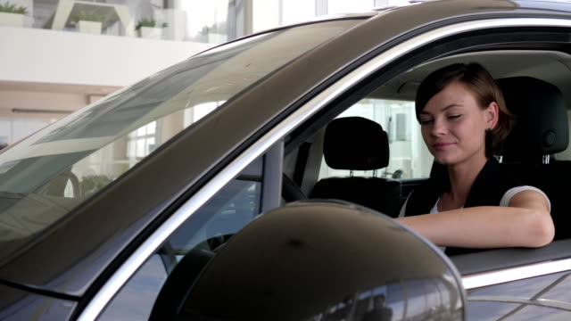 female in autocenter, admiration new car, Good buy, Portrait owner video