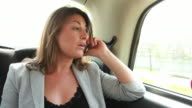 Female in back of cab on the phone video