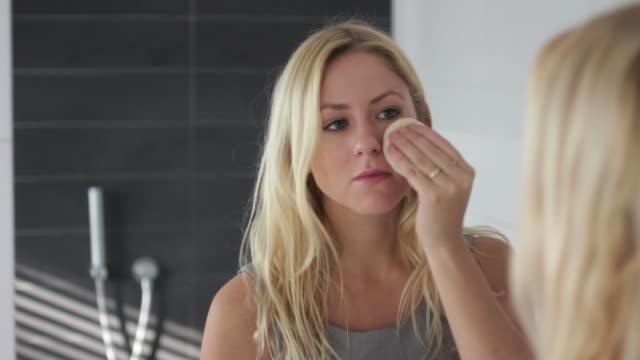 Female in bathroom looking at mirror video