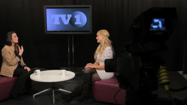 Female in studio interview guest video