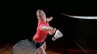SLO MO Female indoor badminton player hitting a shuttlecock video