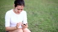 female irritated eyes while using smartphone. video