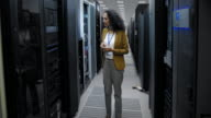 LD Female IT engineer checking the servers in server room video