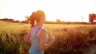 Female Jogger Woman Running at Sunset Listening to Music video