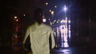 SLO MO TS Female jogging in the city at night video