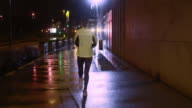 TS Female jogging in the city on a rainy night video