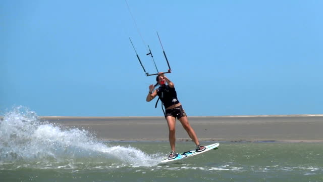 Female kiteboarder performs a trick video
