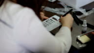 Female lashmaker work on tablet video