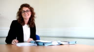 Female lawyer signing documents video