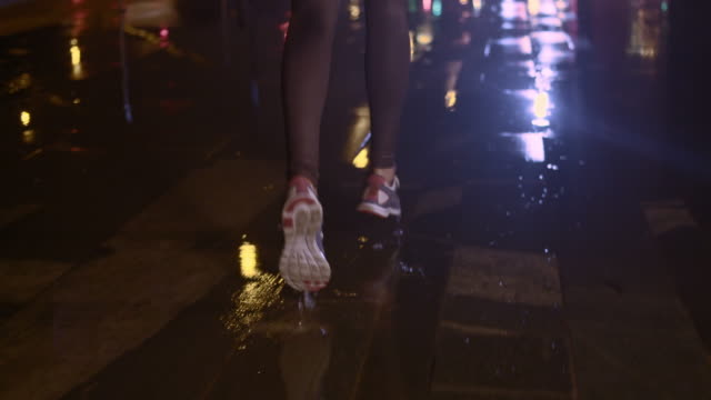 SLO MO TS Female legs jogging in the city at night video