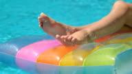 Female Legs on  Raft In Swimming Pool video