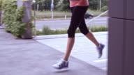 SLO MO TS Female legs running along city street video