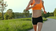 SLO MO TS Female marathon runner running in countryside video