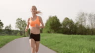 SLO MO TS Female marathon runner running on asphalt road video