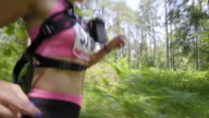 TS Female marathon runner running through forest video