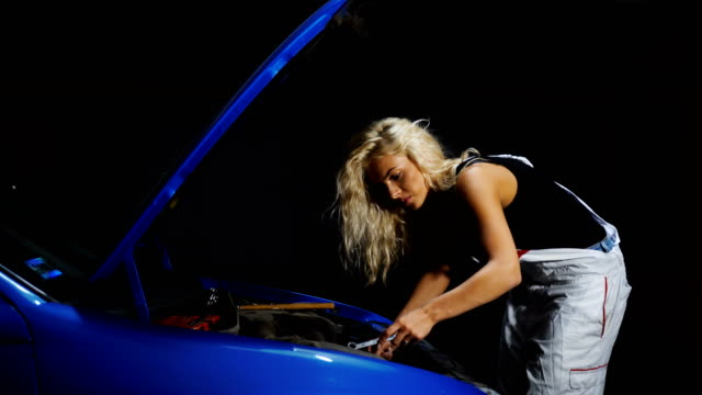 Female mechanic fixing car video