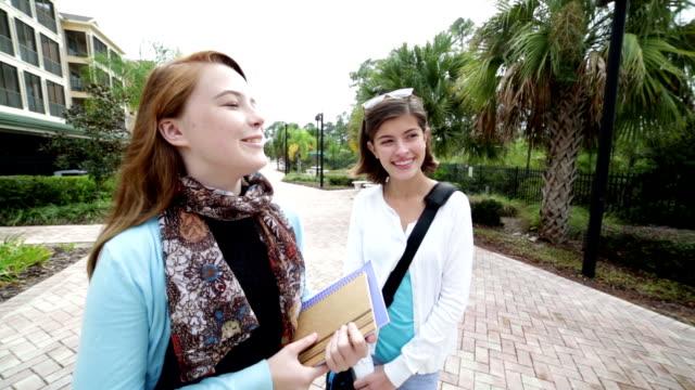 Female middle school students walking after school video