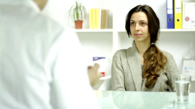 Female Model Accepting rx Prescription Medical Doctor Office video