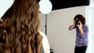 Female model posing for fashion shoot video