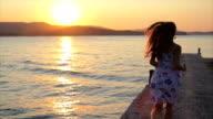 Female Model Running Toward Sunset Jetty Ocean Freedom Concept video