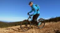 SLO MO Female MTB rider going down the mountain trail video