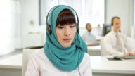 LD Female Muslim call center operator during a video call video