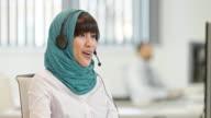 TU Female Muslim call center operator talking to a customer video