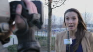 Female news reporter on location video