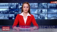 4K Female newsreader with red suit  in television studio video