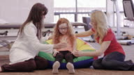 Female occupational therapist working with child patient and her mother video
