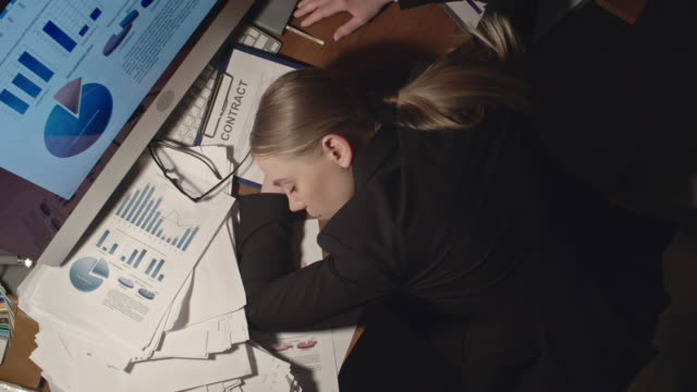 Female Office Worker Sleeping at Workplace video