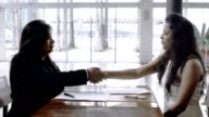 Female Partners Shaking Hands and Signing Contract video