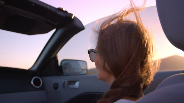 Female Passenger Driving In Convertible Car Shot On R3D video