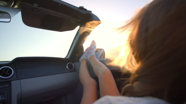 Female Passenger Relaxing In Convertible Car Shot On R3D video