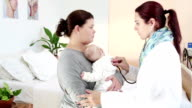 Female pediatrician listen to baby's heart beat consults mother video