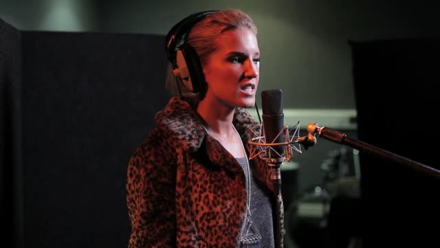 Female performing in recording studio video