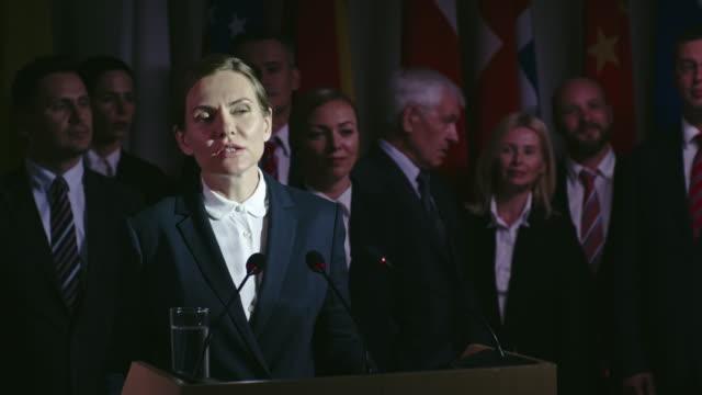 Female Politician behind Tribune video