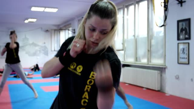 Female practicing self defense exercises video