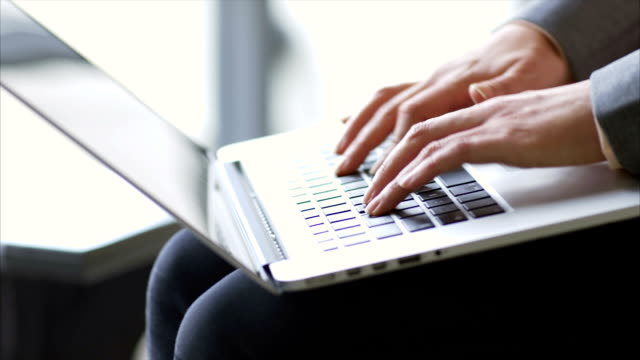 Female professional using laptop in office video