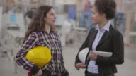 Female quality inspector and female worker talking video
