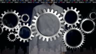 Female researcher engineer touched screen, Connecting Gear wheels, Big Gear wheel. video