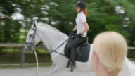 TS Female riding the horse in canter motion video
