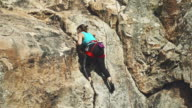 Female rock climber freeclimbing video